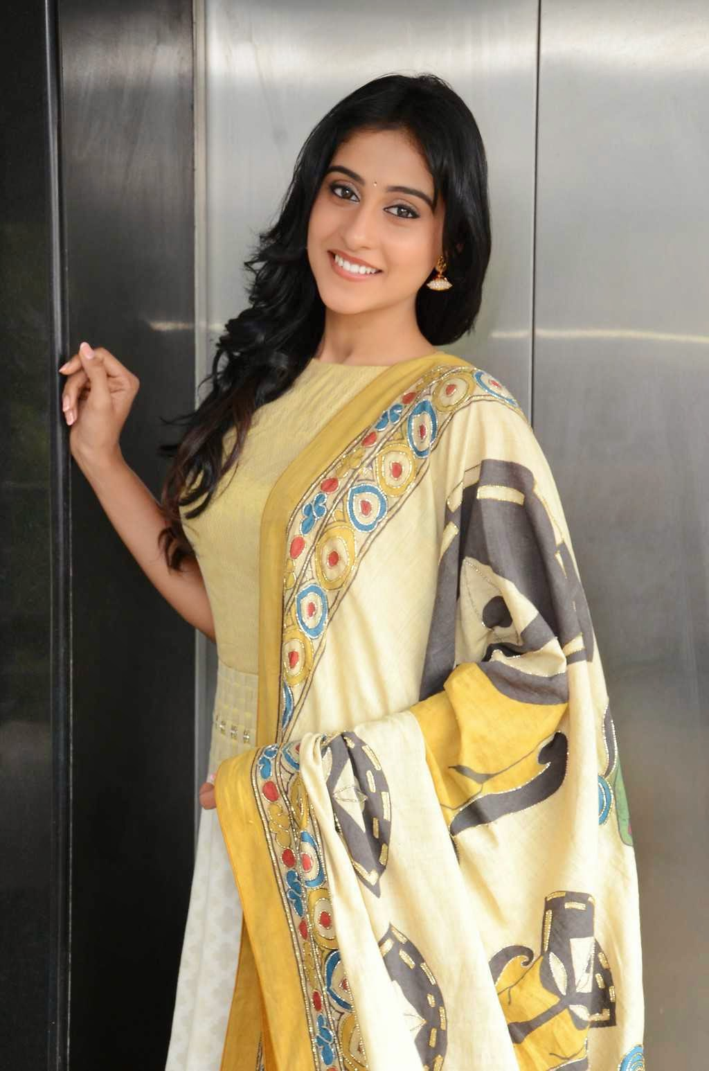 Actress Regina Cassandra Latest Cute Hot Exclusive Beautiful Yellow Dress Spicy Photos Gallery At Subramanyam For Sale Telugu Movie Press Meet (16)